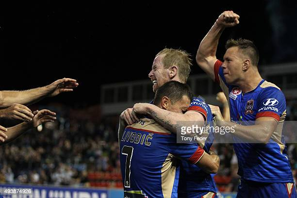 David Carney of the Jets celebrates a goal with team mates during the round three ALeague match between the Newcastle Jets and the Melbourne Victory...