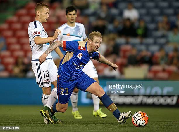 David Carney of the Jets contests the ball with Oliver Bozanic of the Victory during the round three ALeague match between the Newcastle Jets and the...
