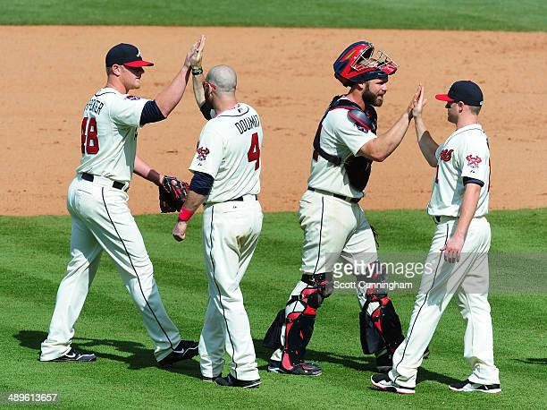 David Carpenter, Ryan Doumit, Evan Gattis, and Tyler Pastornicky of the Atlanta Braves celebrate after the game against the Chicago Cubs at Turner...
