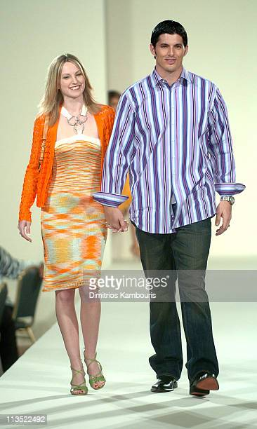 David Carr and wife wearing fashions presented by Saks Fifth Avenue at the Gridiron Glamour fashion show