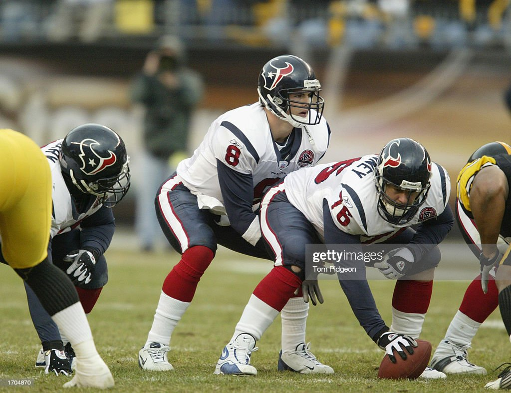 David Carr #8 of the Houston Texans prepares to take the snap from teammate Steve McKinney #76 during a game against the Pittsburgh Steelers on December 8, 2002 at Heinz Field in Pittsburgh, Pennsylvania. The Texans beat the Steelers 24-6.