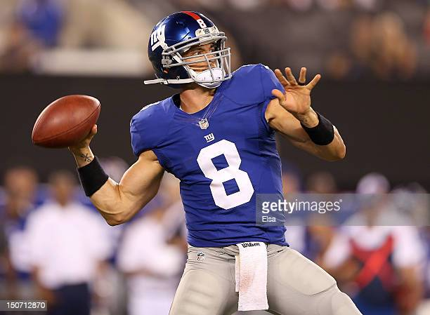 David Carr of the New York Giants passes the ball in the fourth quarter against the Chicago Bears during a preseason game on August 24 2012 at...