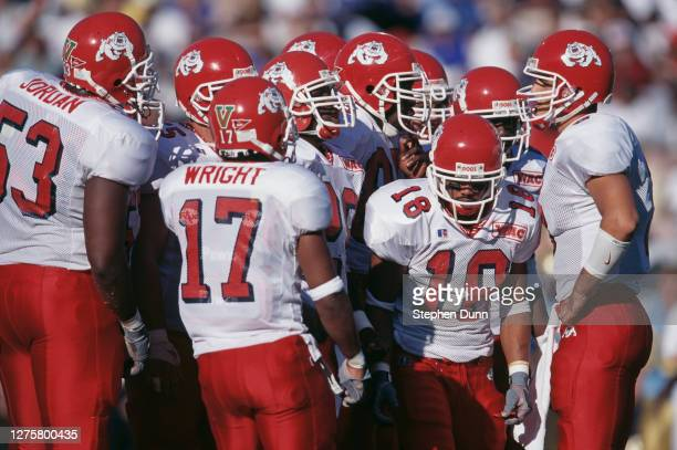 David Carr, Quarterback for the Fresno State Bulldogs instructs his offensive line in the huddle during the NCAA Pac-10 Conference college football...