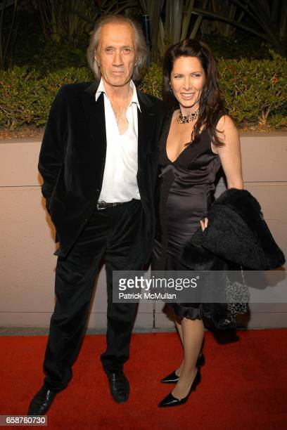 David Carradine and Annie Bierman attend Miramax 'Max Awards' arrivals at The St Regis Hotel on February 28 2004 in Los Angeles CA