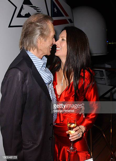 David Carradine and Annie Bierman during 2004 Cannes Film Festival Budweiser Hosts Alicia Keys Party at The Big Eagle Yacht Port de Cannes in Cannes...