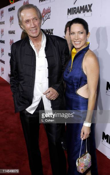 David Carradine and Annie Bierman during 'Kill Bill Vol 1' Premiere Red Carpet at Grauman's Chinese Theater in Hollywood California United States