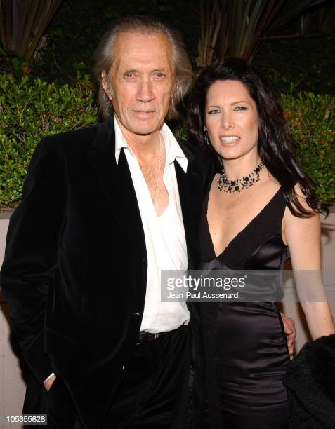 David Carradine and Annie Bierman during Miramax Annual PreOscar Party Arrivals at St Regis Hotel in Century City California United States