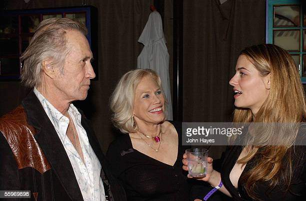 David Carradine from left Margaret Blye and Clementine Ford chat during the DVD release party for Last Goodbye October 19 in Los Angeles California