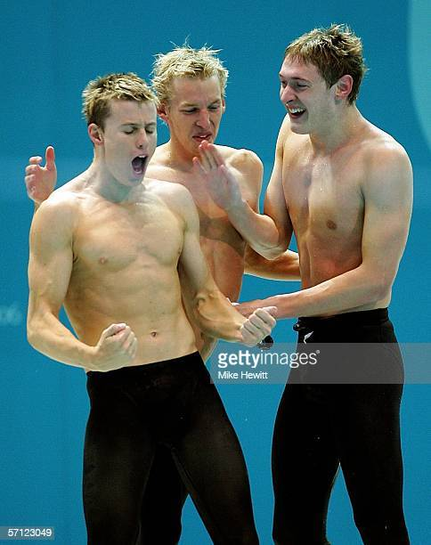 David Carry Euan Dale and Andrew Hunter celebrate after they won silver during the final of the mens 4 x 200 metres freestyle relay at the Melbourne...