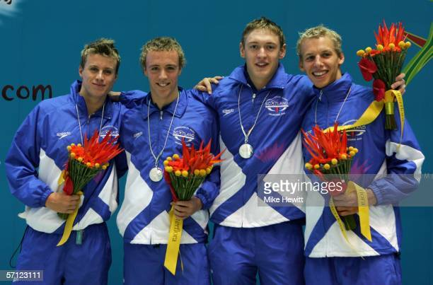David Carry Euan Dale Andrew Hunter and Robert Renwick of Scotland pose with their medals after the men's 4 x 200 metres freestyle relay final at the...