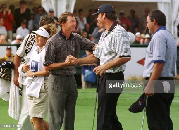 David Carter and Nick Faldo congratulate each other winning the Golf World Cup 22 November. The pair won with a score of eight under par two shots...