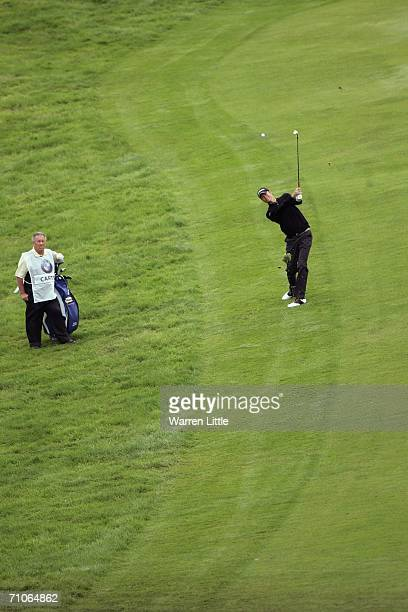 David Carter of England hits his approach shot on the first hole during the Third Round of the BMW Championship at The Wentworth Club on May 27, 2006...