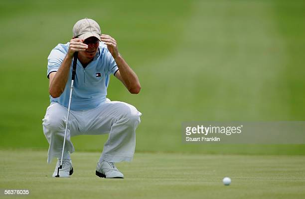 David Carter of England lines up his putt on the fourth hole during the first round at The Dunhill Championships at The Leopard Creek Country Club on...