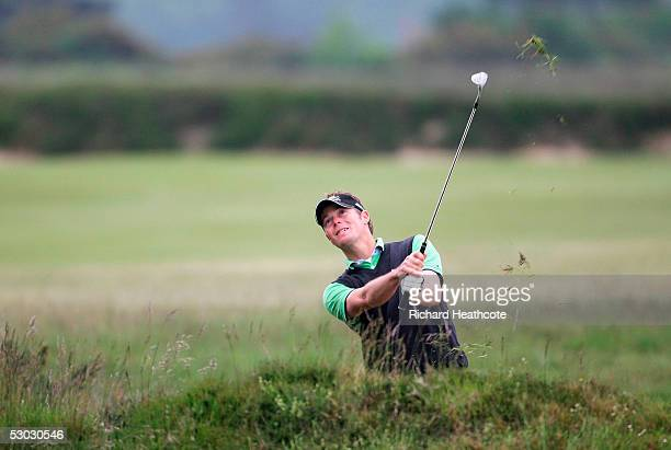 David Carter of England pitches onto the 14th green during The 2005 US Open Qualifier, held at Walton Heath Golf Club on June 6, 2005 in...