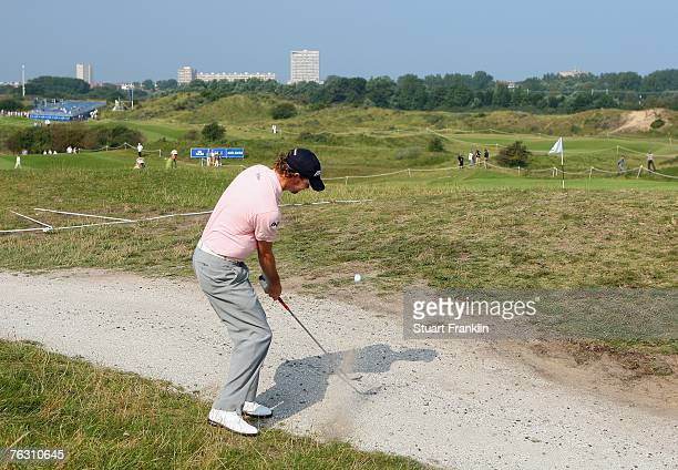 David Carter of England plays his chip shot on the 11th hole during the second round of The KLM Open at Kennemer Golf & Country Club on August 24,...