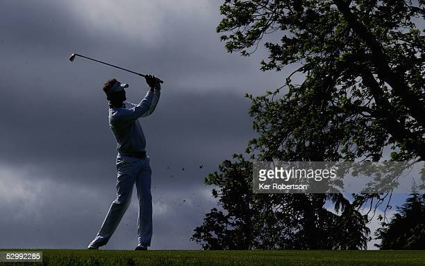 David Carter of England plays his second shot at the 1st hole during the third round of the BMW Championship 2005 at the Wentworth Club on May 28...