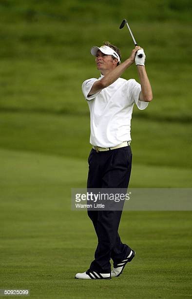 David Carter of England plays his second shot into the 13th green during the second round of the 2004 Celtic Manor Wales Open at Celtic Manor Golf...