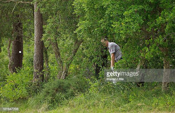 David Carter of England plays out of the trees on the second hole during the first round of the Estoril Open de Portugal at Penha Longa Golf Club on...