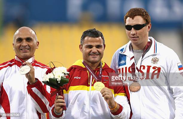 David Casinos Sierra of Spain poses with his gold medal Bil Marinkovic of Austria silver and Vitalii Telesh of Rusia bronze for the men's discus F11...