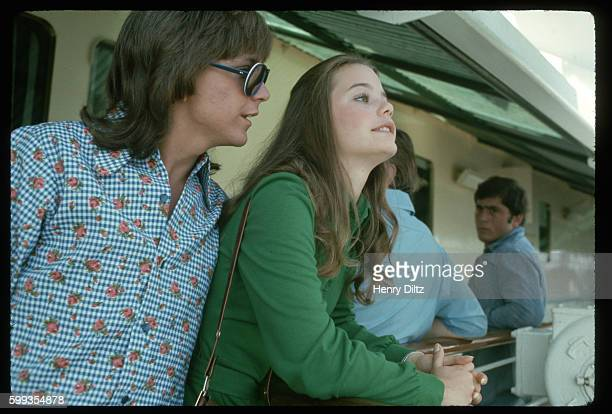 David Cassidy and Susan Dey wait on deck for their call to the set on the Fairseas cruise ship where they are filming of an episode of 'The Partridge...