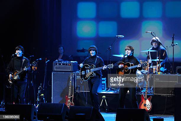 David CatlinBirch Andre Barreau Adam Hastings and Hugo Degenhardt of The Bootleg Beatles perform on stage at HMV Hammersmith Apollo on December 19...