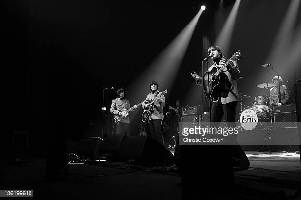 David CatlinBirch Andre Barreau Adam Hastings and Hugo Degenhardt of The Bootleg Beatles perform on stage at the Hammersmith Apollo on December 19...