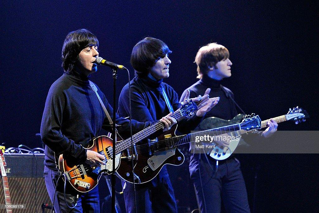 David Catlin-Birch (Paul McCartney), Andre Barreau (George Harrison) and Adam Hastings (John Lennon) of The Bootleg Beatles perform on stage at HMV Hammersmith Apollo on December 19, 2011 in London, United Kingdom.