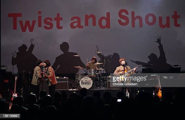 David CatlinBirch Andre Barreau Hugo Degenhardt and Adam Hastings of The Bootleg Beatles perform on stage at the Hammersmith Apollo on December 19...