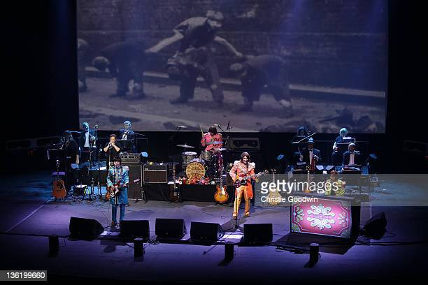 David CatlinBirch Hugo Degenhardt Andre Barreau and Adam Hastings of The Bootleg Beatles perform on stage at the Hammersmith Apollo on December 19...