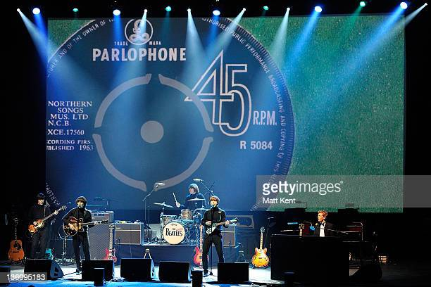 David CatlinBirch Paul McCartney Andre Barreau Hugo Degenhardt and Adam Hastings of The Bootleg Beatles perform on stage at HMV Hammersmith Apollo on...