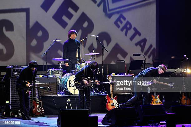 David CatlinBirch Paul McCartney Hugo Degenhardt Andre Barreau and Adam Hastings of The Bootleg Beatles perform on stage at HMV Hammersmith Apollo on...