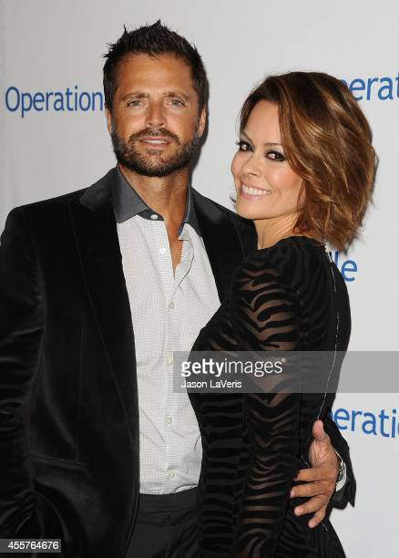 David Charvet and Brooke Burke Charvet attend the 2014 Operation Smile gala at the Beverly Wilshire Four Seasons Hotel on September 19 2014 in...