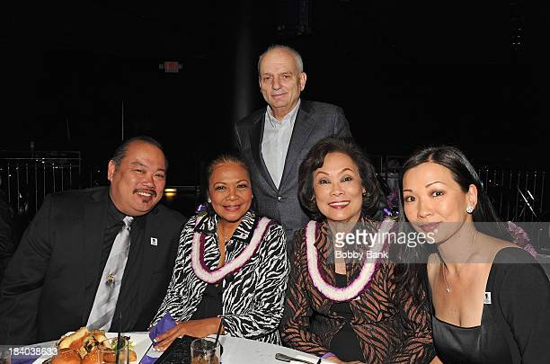 David Chase Deborah Lin and her motheri attends the Wounded Warrior Project Carry Foward Awards Arrivals at Club Nokia on October 10 2013 in Los...