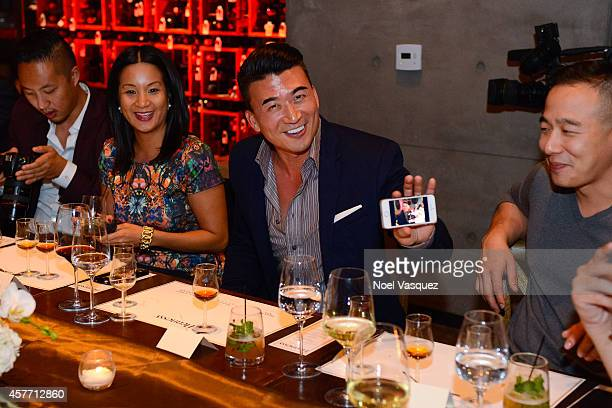 David Christopher Lee Hennessy West Coast Marketing Manager ThuyAnh J Nguyen and Eddie Ha attend Maurice Hennessy private tasting and dinner at AnQi...