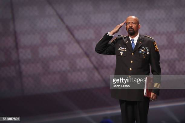David Clarke Jr sheriff of Milwaukee County Wisconsin salutes as he leaves the stage after speaking at the NRAILA's Leadership Forum at the 146th NRA...