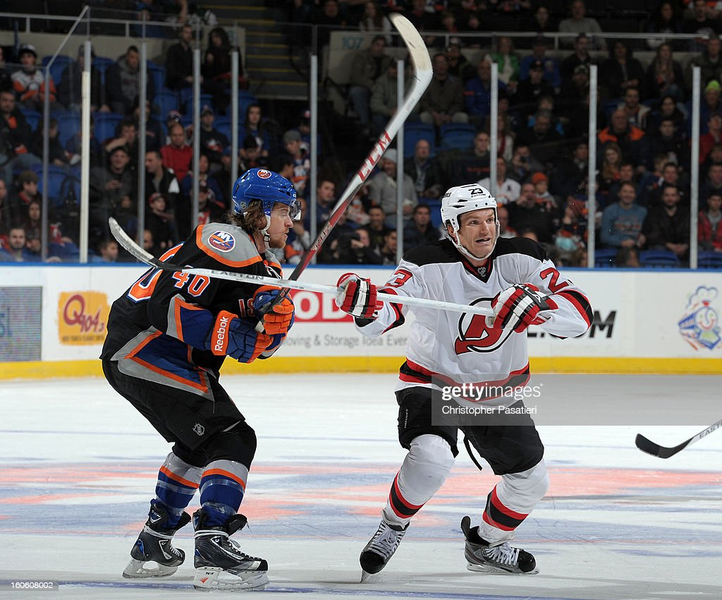 David Clarkson #23 of the New Jersey Devils faces off against Michael Grabner #40 of the New York Islanders during the game on February 3, 2013 at Nassau Veterans Memorial Coliseum in Uniondale, New York.