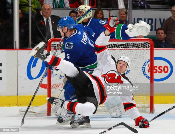 David Clarkson of the New Jersey Devils gets tripped up by Christian Ehrhoff of the Vancouver Canucks during their game Rogers Arena on November 1,...