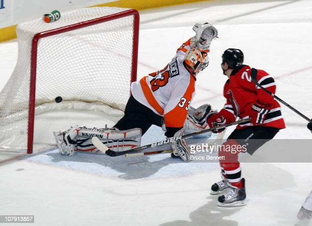 David Clarkson of the New Jersey Devils scores a second period goal against Brian Boucher of the Philadelphia Flyers at the Prudential Center on...