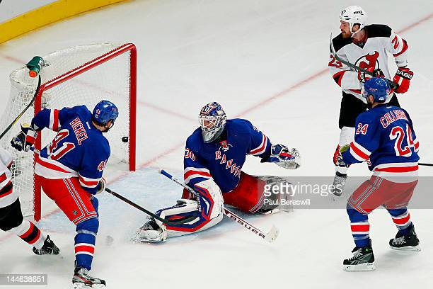 David Clarkson of the New Jersey Devils scores a third period goal past Henrik Lundqvist of the New York Rangers in Game Two of the Eastern...