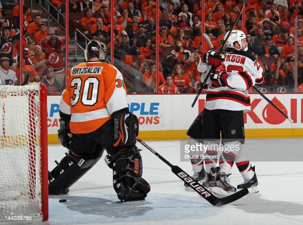 David Clarkson of the New Jersey Devils scores at 1245 of the first period on a giveaway by Ilya Bryzgalov of the Philadelphia Flyers and is joined...
