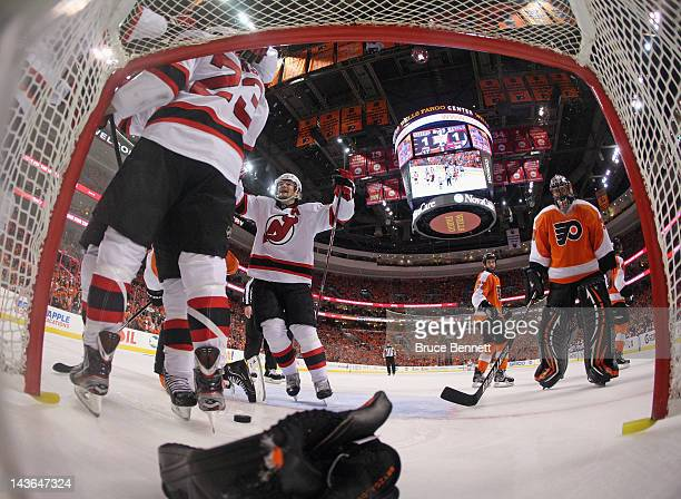 David Clarkson of the New Jersey Devils scores the game winning goal at 1117 of the third period and is joined by Patrik Elias in the game against...