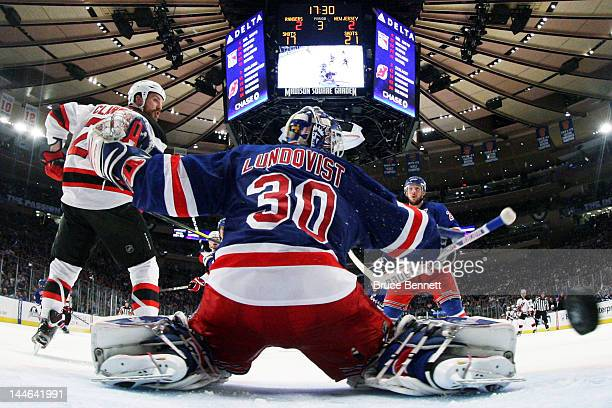 David Clarkson of the New Jersey Devils scores the winning third period goal past Henrik Lundqvist of the New York Rangers in Game Two of the Eastern...