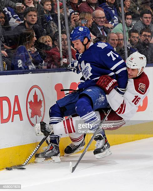 David Clarkson of the Toronto Maple Leafs battles for the puck with Rostislav Klesla of the Phoenix Coyotes during NHL game action December 19 2013...