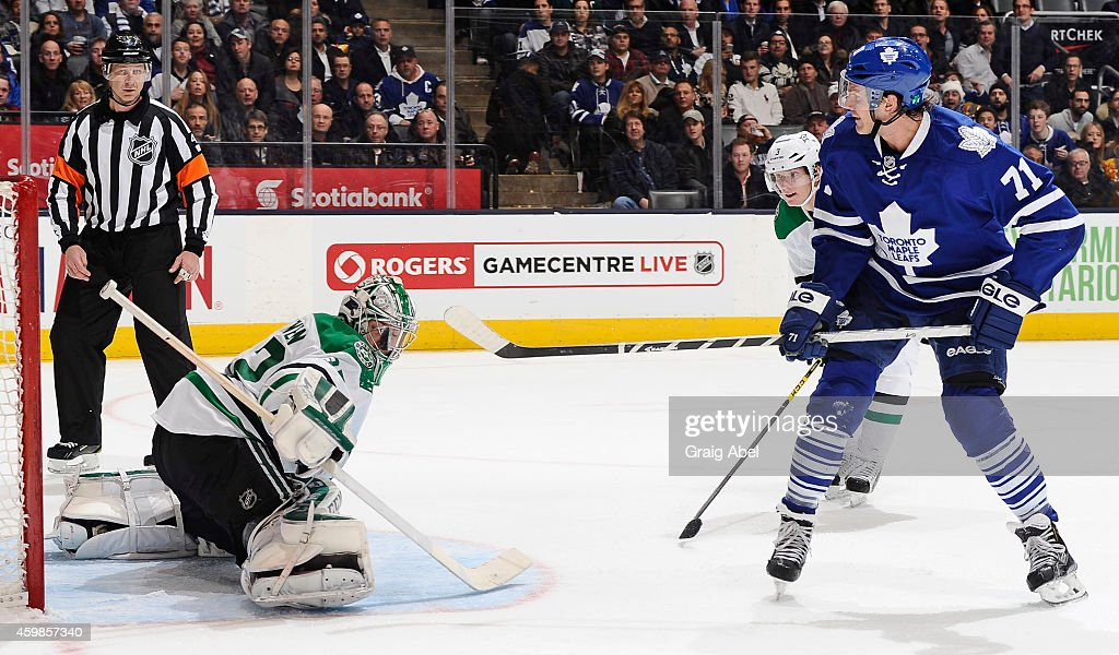 David Clarkson #71 of the Toronto Maple Leafs is stopped in close by Kari Lehtonen #32 of the Dallas Stars during NHL game action December 2, 2014 at the Air Canada Centre in Toronto, Ontario, Canada.