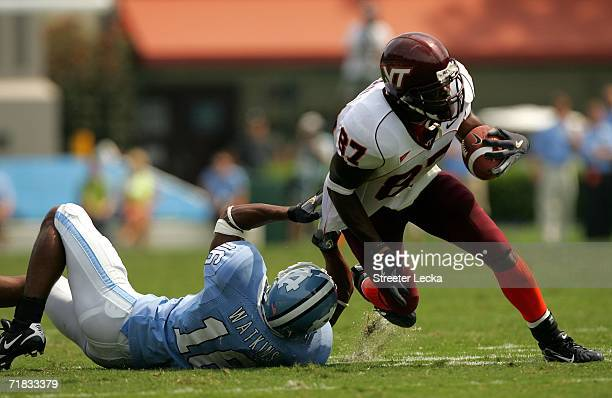 David Clowney of the Virginia Tech Hokies breaks a tackle by Jacoby Watkins of the University of North Carolina Tar Heels on September 9 2006 at...