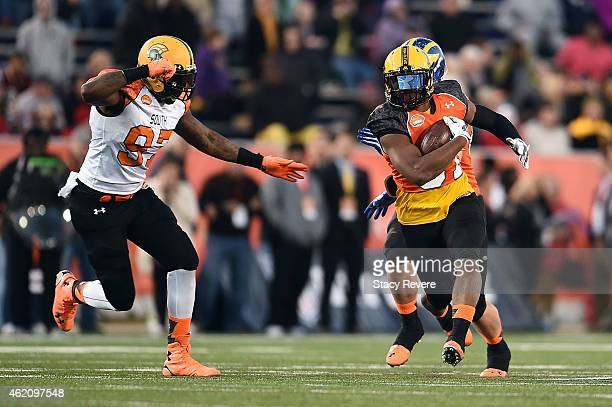 David Cobb of the North team is pursued by Lynden Trail of the South team during the third quarter of the Reese's Senior Bowl at Ladd Peebles stadium...