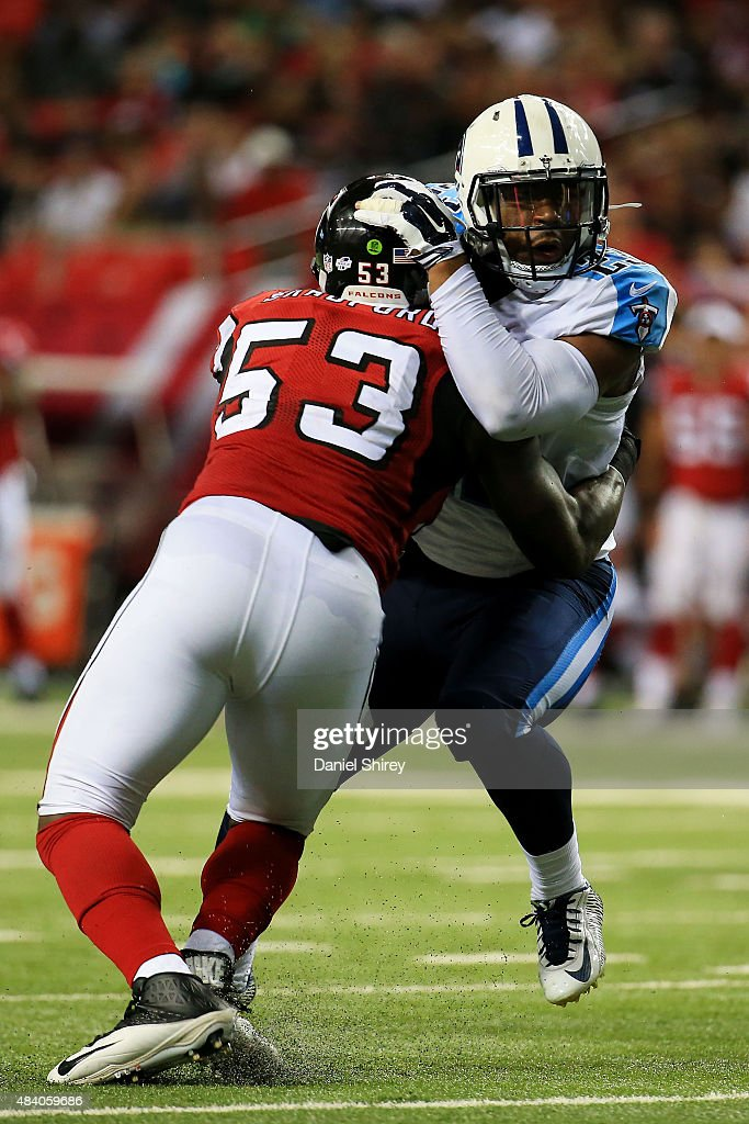 David Cobb #23 of the Tennessee Titans is tackled by Allen Bradford #53 of the Atlanta Falcons in the second half of a preseason game at the Georgia Dome on August 14, 2015 in Atlanta, Georgia.