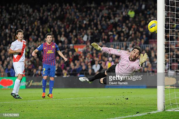 David Cobeno of Rayo Vallecano looks on the ball as Alexis Sanchez of FC Barcelona shoots to score the opening goal during the La Liga match between...