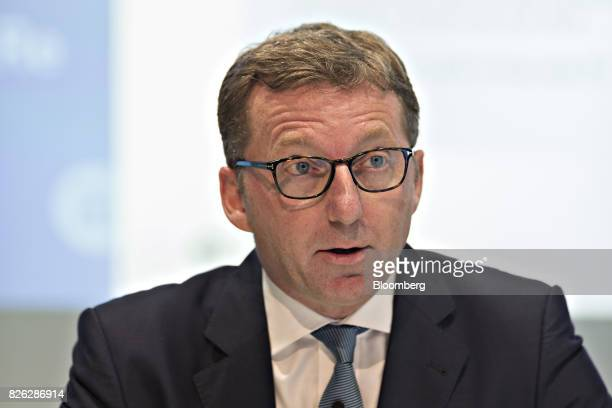 David Cole chief financial officer of Swiss Re AG speaks during a news conference to announce the company's firsthalf results in Zurich Switzerland...
