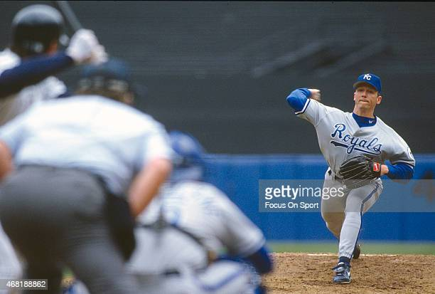 David Cone of the Kansas City Royals pitches against the New York Yankees during an Major League Baseball game circa 1993 at Yankee Stadium in the...
